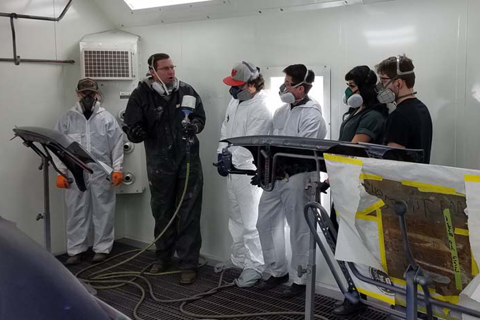 students in automotive paint class