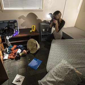 A woman photographing a crime scene