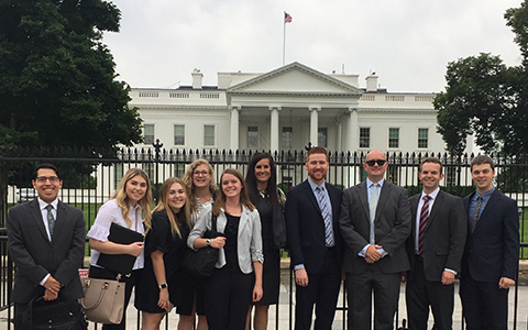 nss students pose in front of the white house in washington DC